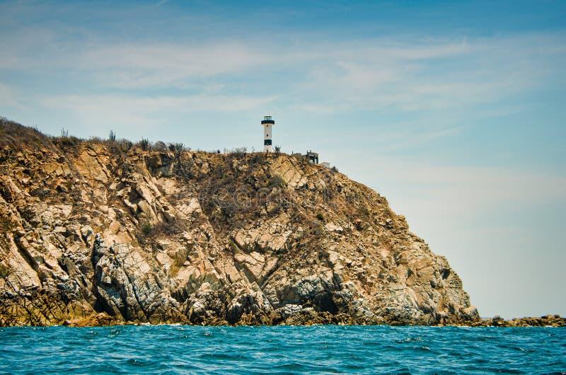 Lighthouse on the rock in Bahias de Huatulco, Mexico, Oaxaca.  royalty free stock photos