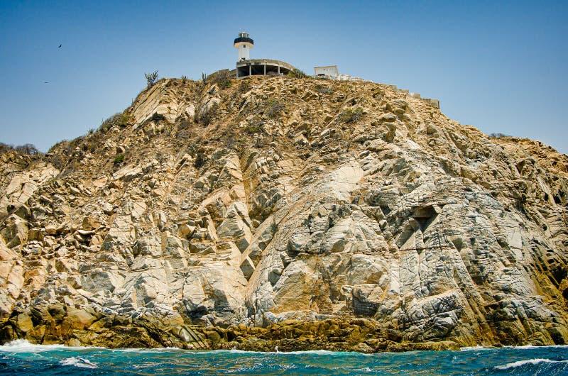 Lighthouse on the rock in Bahias de Huatulco, Mexico, Oaxaca.  stock photography