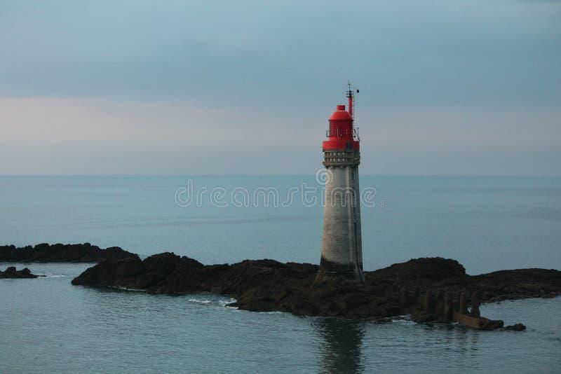 Lighthouse on Rocks stock image