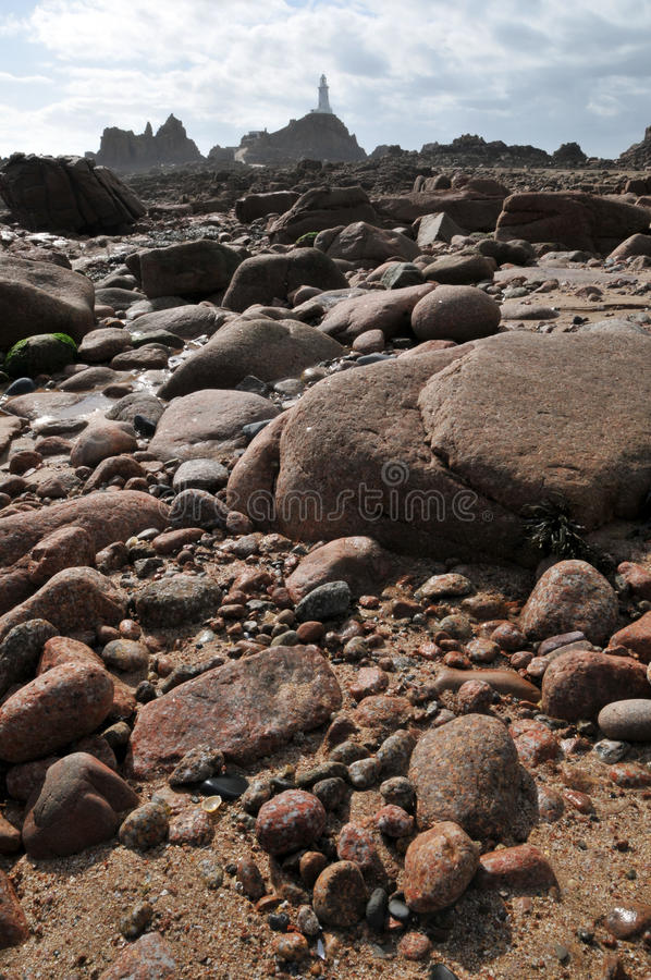 La Corbiere Lighthouse with rocks Jersey royalty free stock photography