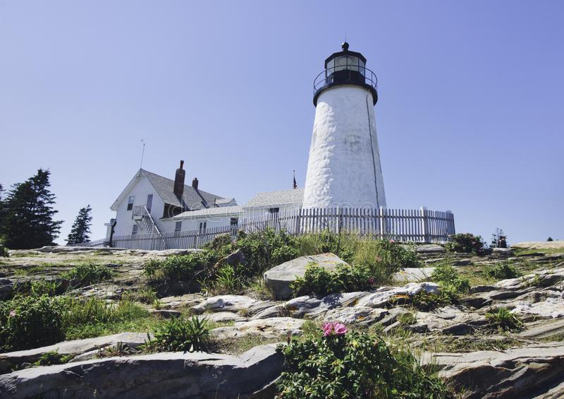 Lighthouse on rocks in Maine royalty free stock image