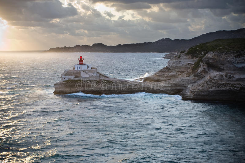 Lighthouse On Rocks Over The Sea Royalty Free Stock Photography