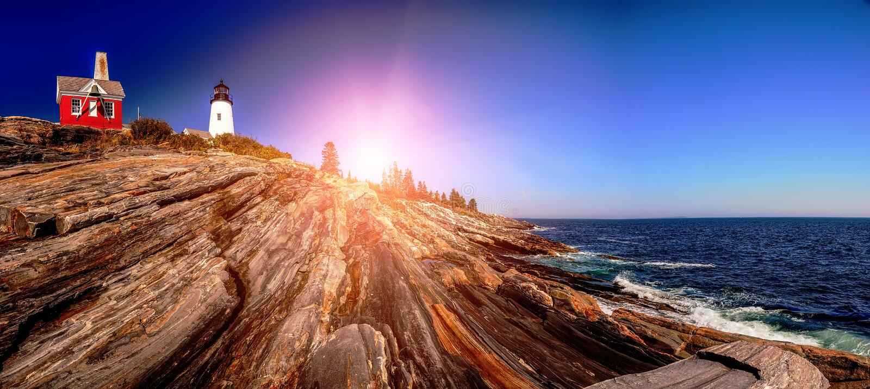 Lighthouse on a rocky high bank of the Atlantic Ocean. Maine, USA. stock photography