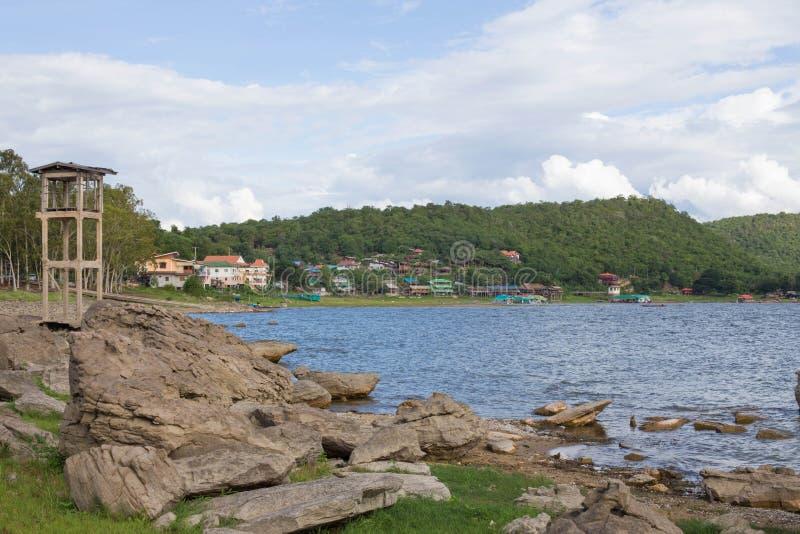 Lighthouse on the rocky island stock image
