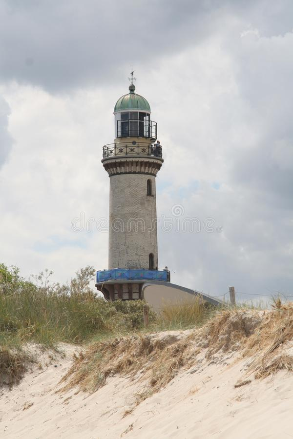 Lighthouse at the coastline, warnemuende, rostock, germany stock photos