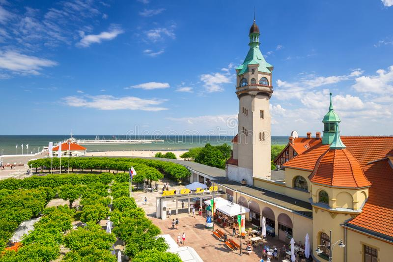 Lighthouse by the sea and Baltic pier (polish: Molo) in Sopot, Poland. Summer, promenade, beach, people, square, blue, sky, sunbathing, holiday royalty free stock images