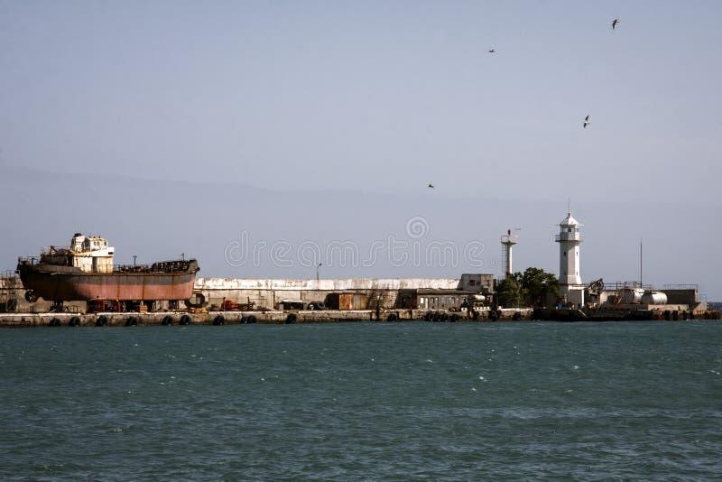 Lighthouse in the sea, ship stock photos