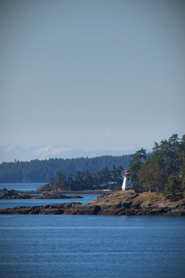 Lighthouse on seashore, canada royalty free stock photo