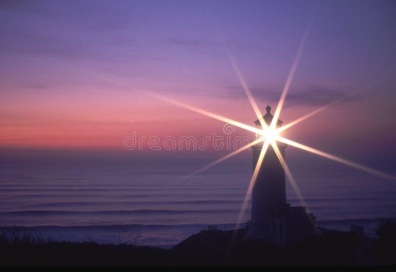 Pacific Coast Lighthouse shining Sunset Sunstar royalty free stock image