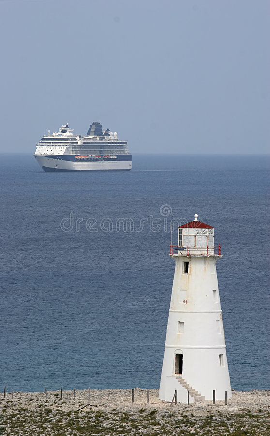 Lighthouse and Ship royalty free stock image