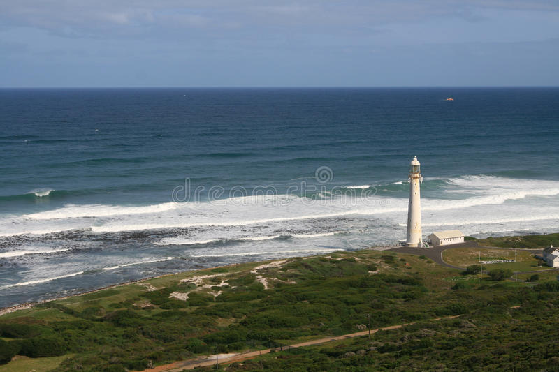 Lighthouse on the shore. Lighthouse on the beach next to the ocean on a clear day. Between Cape Town and Cape of good hope stock images