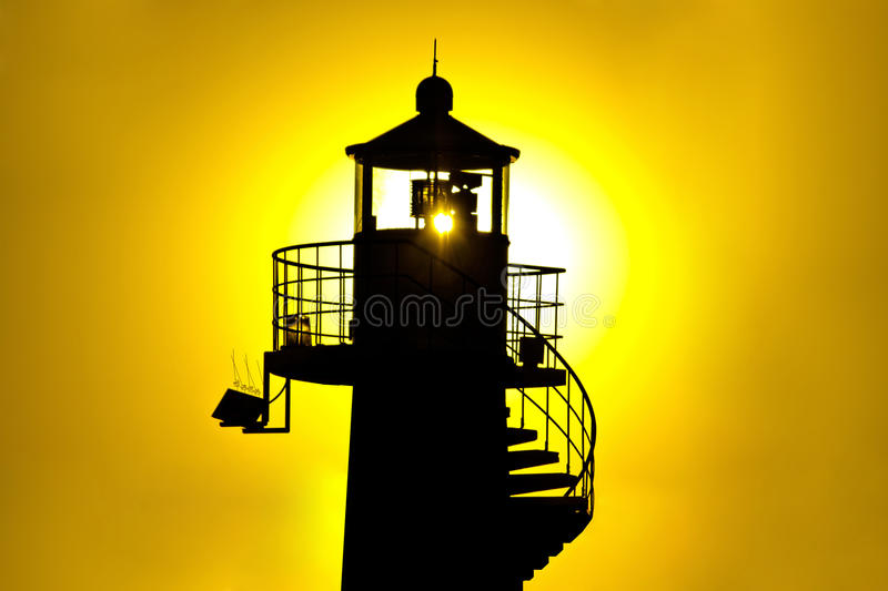 Download Lighthouse Silhouetteat Yellow Sunset Royalty Free Stock Photo - Image: 26638205