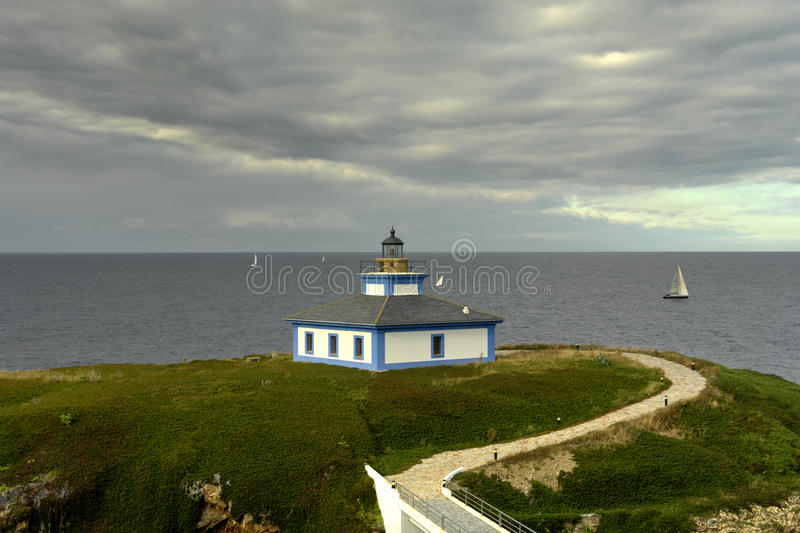 Lighthouse. Small lighthouse at the coast of north of spain stock images