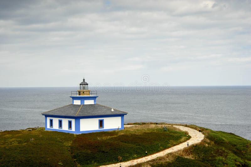 Lighthouse. Small lighthouse at the coast of north of spain stock photos