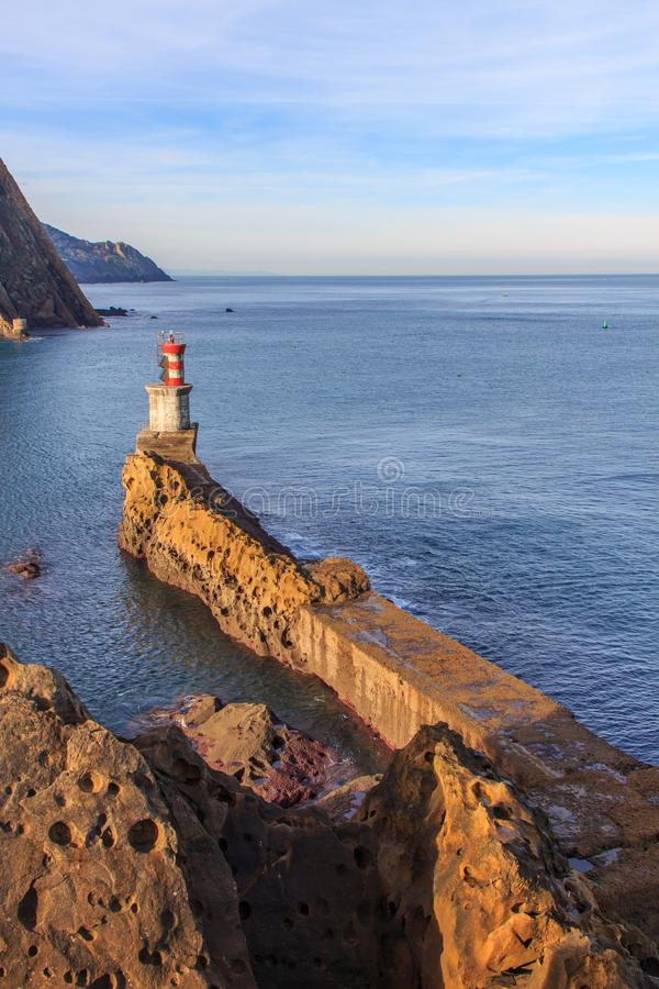 The lighthouse of the small fishing village of Pasai Donibane in Guipuzcoa.  stock photography