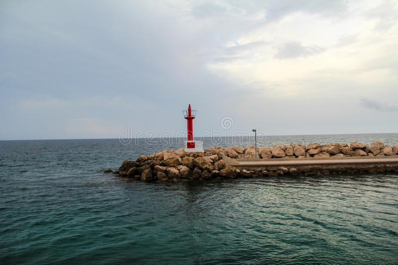 Lighthouse. A small lighthouse on the seafront royalty free stock photography