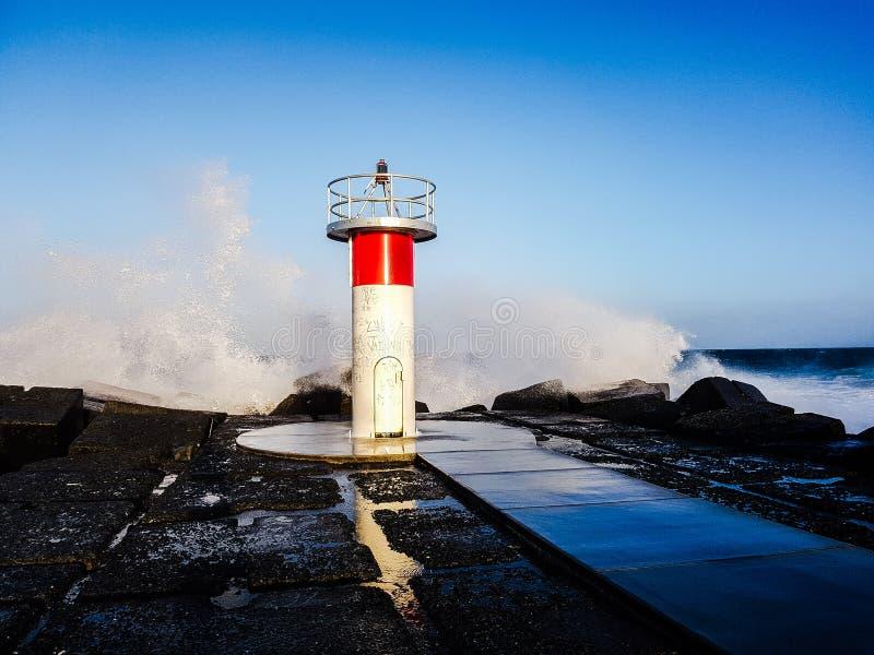 Lighthouse sprayed royalty free stock image
