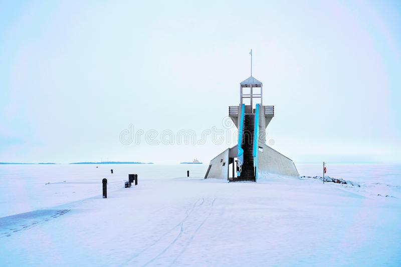 Lighthouse with staircase at Baltic Sea in winter Oulu. Lighthouse with staircase at the Baltic Sea in winter Oulu, Lapland, Finland stock photography