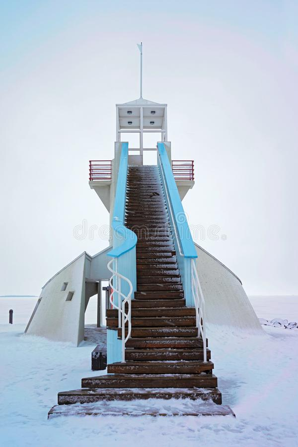 Lighthouse with stairs at Baltic Sea in winter Oulu. Lighthouse with stairs at the Baltic Sea in winter Oulu, Lapland, Finland royalty free stock images