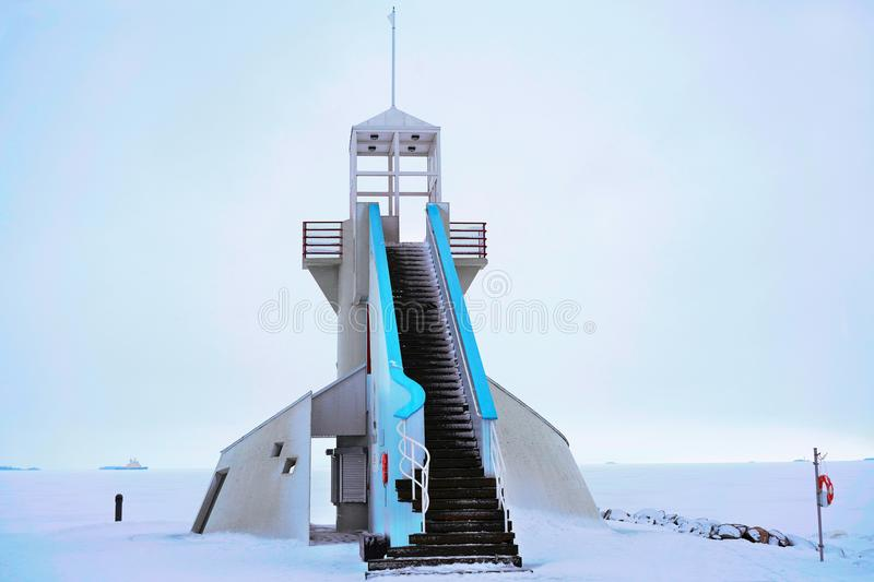 Lighthouse with steps at Baltic Sea in winter Oulu. Lighthouse with steps at the Baltic Sea in winter Oulu, Lapland, Finland stock photography
