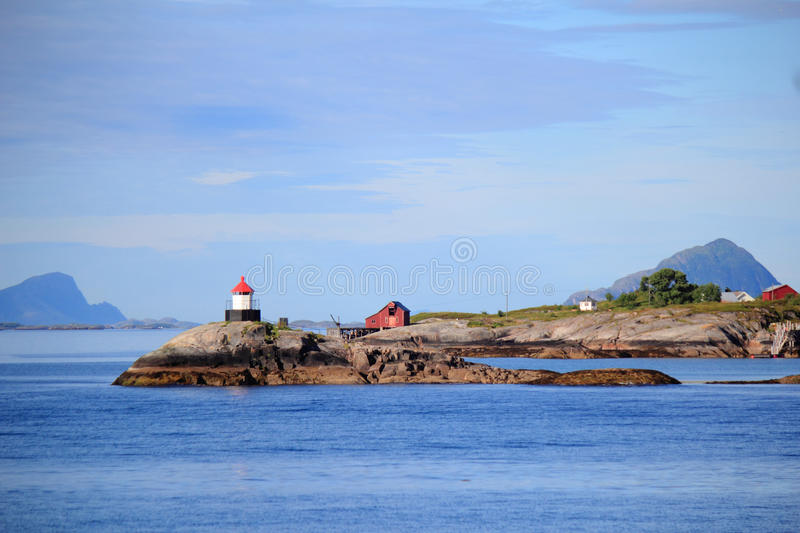 Lighthouse of Stoetts islands. Small norwegian lighthouse in Stoett islands, polar circle stock images