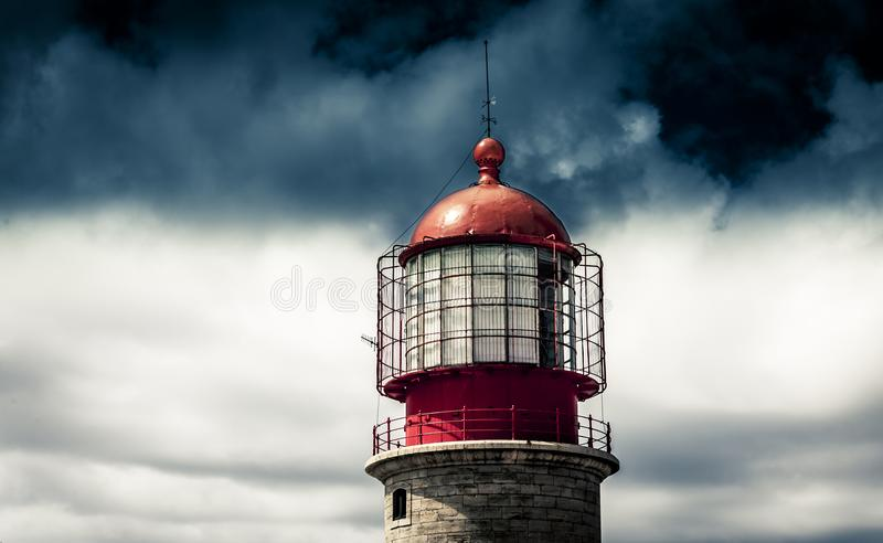 Lighthouse during stormy weather in afternoon stock images