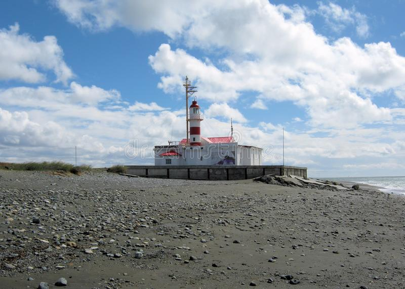 Lighthouse Straits of Magellan with shore, clouds, Punta Delgada, Chile. Punta Delgada Lighthouse at the car ferry Straits of Magellan with shore and clouds stock images