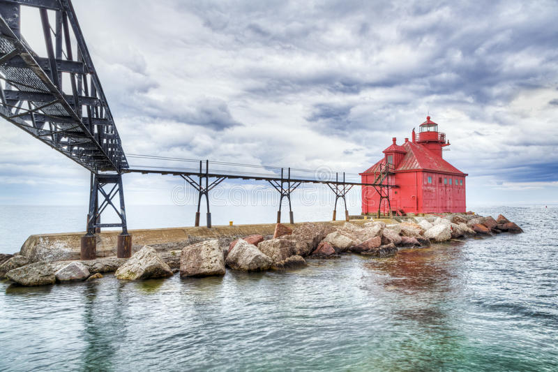 Lighthouse at Sturgeon Bay. The Sturgeon Bay Ship Canal North Pierhead Lighthouse, with its elevated catwalk approach, has aided navigation on Lake Michigan stock photos