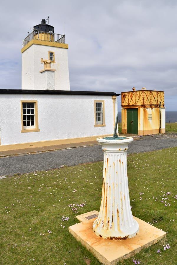Lighthouse sundial. Elegantly designed sundial shaped like an old lighthouse standing in front of Eshaness Lighthouse, Northmavine, Mainland, Shetland royalty free stock photo