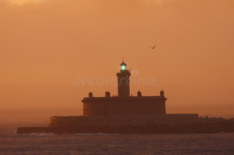 Lighthouse at Sunrise stock photo