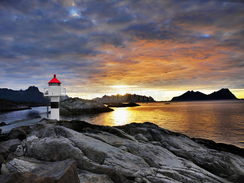 Lighthouse Sunrise Coastline, Lofoten stock photo