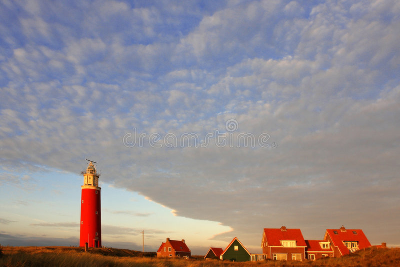 Lighthouse at sunset royalty free stock image