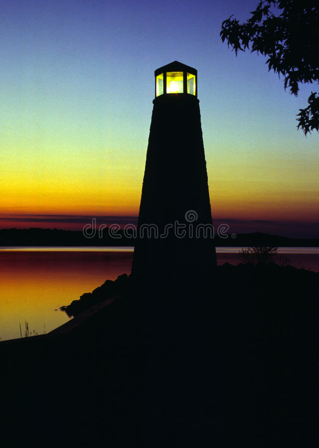 Lighthouse at Sunset. A small lighthouse at sunset. Located at Lake Anna, Virginia stock image