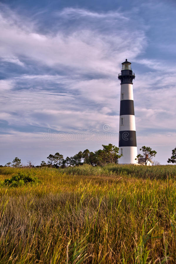 Free Lighthouse Surrounded By Clouds And Marshland Stock Images - 45439974