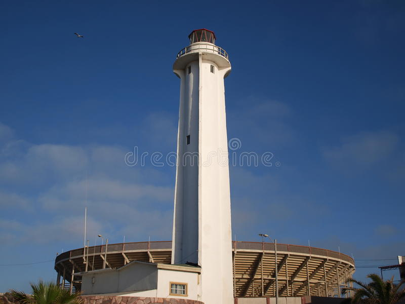 Lighthouse of Tijuana in the evening. The Lighthouse of Playas de Tijuana in the evening with the bullring at the background. These are historical buildings in royalty free stock photo