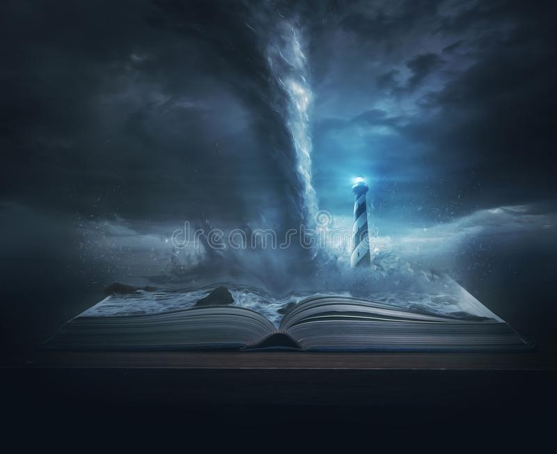 Lighthouse and Tornado. A big storm and tornado on top of the pages of a Bible with a bright lighthouse royalty free stock photography