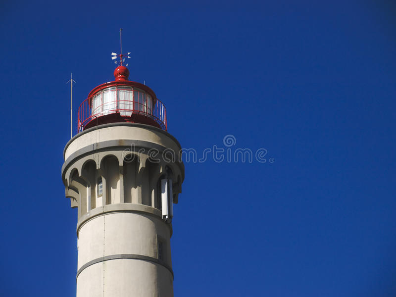 Lighthouse tower with blue sky as background royalty free stock image