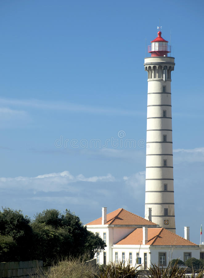Lighthouse tower with blue sky as background stock images