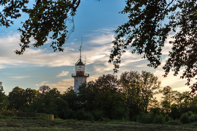 Lighthouse between trees, located located in Jastrzebia Gora at the Baltic Sea coast Poland.  stock image