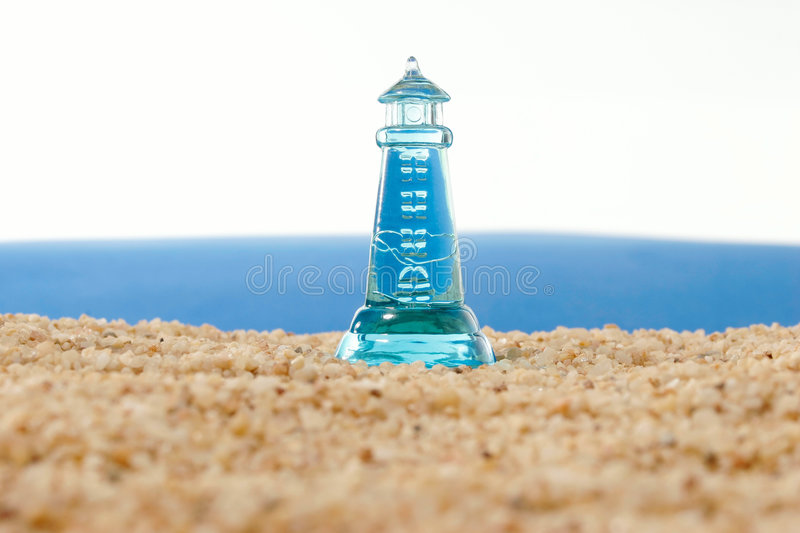 Lighthouse before a turbulent sea royalty free stock image