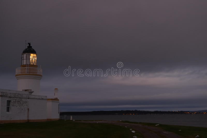 Lighthouse in twilight stock photos