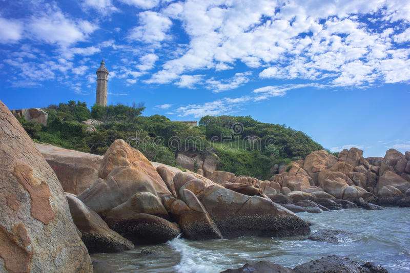 Lighthouse under blue sky and cloud stock photos