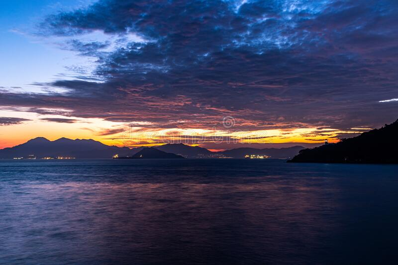 Lighthouse of Victoria Harbour at dusk royalty free stock photography