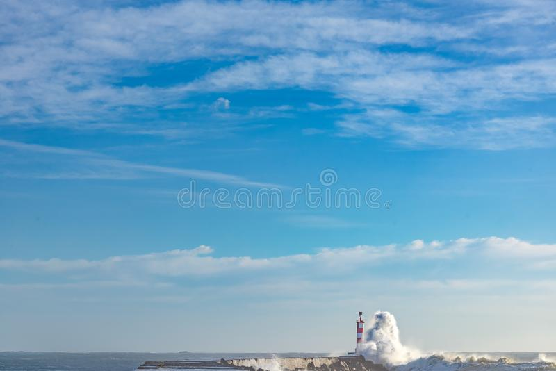 Seascpe of the lighthouse of Vila do Conde. View of the lighthouse and the bay of Vila do Conde city in north of Portugal sunny day intense colors minimal royalty free stock photos