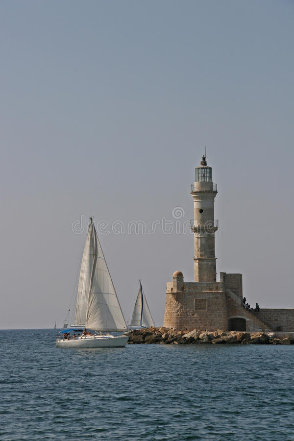 Lighthouse and yacht royalty free stock photos