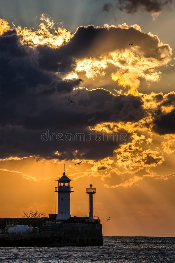 Lighthouse in Yalta at sunrise, a view from the central city embankmen royalty free stock photo