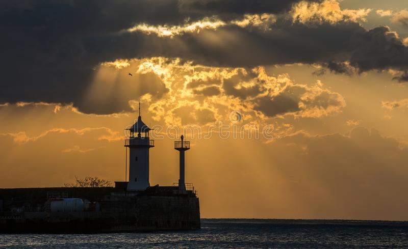 Lighthouse in Yalta at sunrise, a view from the central city embankment royalty free stock image