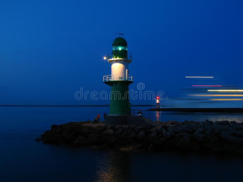 Lighthouses in a harbour entrance stock photography