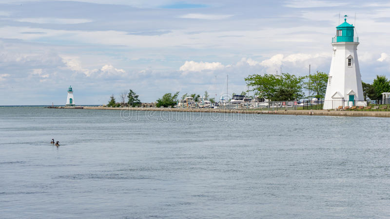 Lighthouses and marina at Port Dalhousie in St Catharines, Ontario, Canada. Ducks swimming in the canal at Port Dalhousie in St Catharines Ontario Canada with royalty free stock image