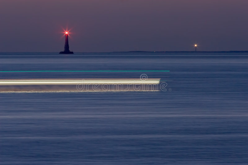 Lighthouses by night royalty free stock photos